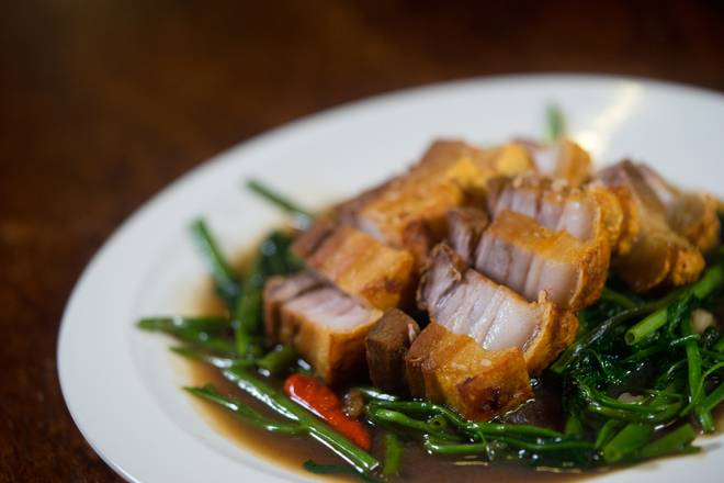 Stir fried Asian water spinach with garlic, chilli, topped with crispy pork belly.